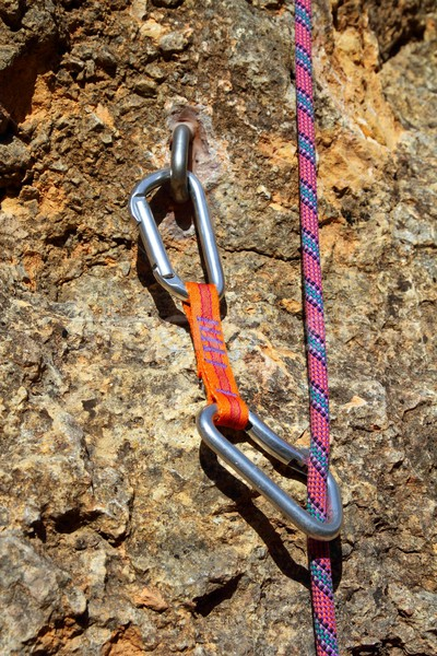 climbing shackles and rope on a rock wal Stock photo © lunamarina