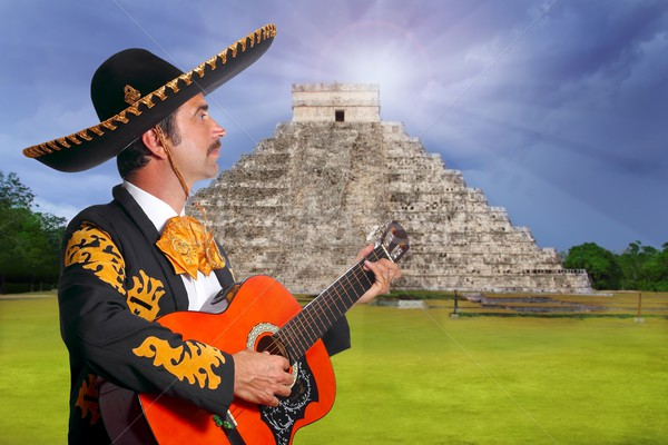 Charro Mariachi playing guitar in Chichen Itza Stock photo © lunamarina