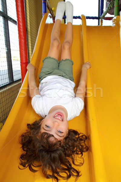 De cabeça para baixo little girl recreio deslizar risonho feliz Foto stock © lunamarina