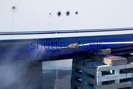 Boat hull cleaning water pressure washer Stock photo © lunamarina