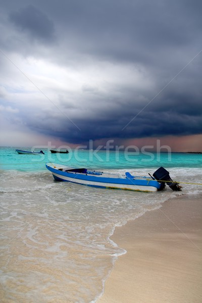 Caribbean before tropical storm hurricane beach boat Stock photo © lunamarina