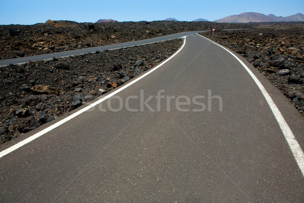 Black volcanic soil and road detail in Lanzarote Stock photo © lunamarina