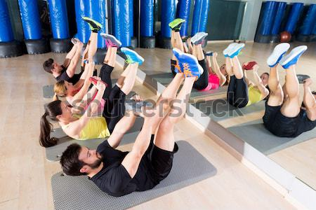 Aerobics pilates women with rubber bands in a row Stock photo © lunamarina