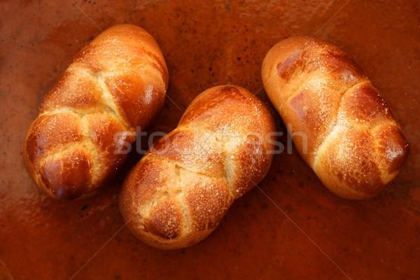 Three brioche pastries over orange clay Stock photo © lunamarina