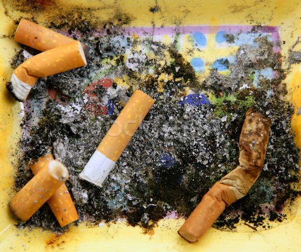 Hamutartó tele cigaretta koszos dohány textúra Stock fotó © lunamarina