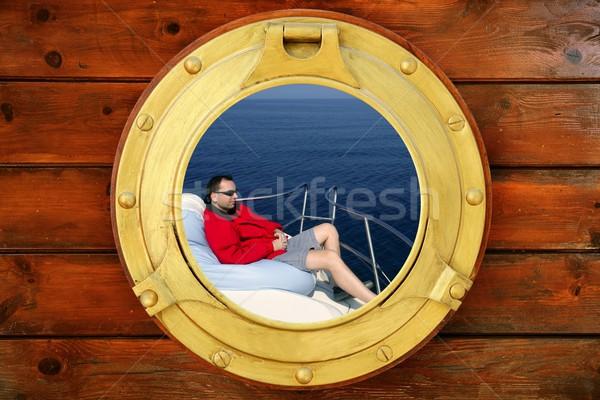 Homem saco de feijão azul mar janela Foto stock © lunamarina