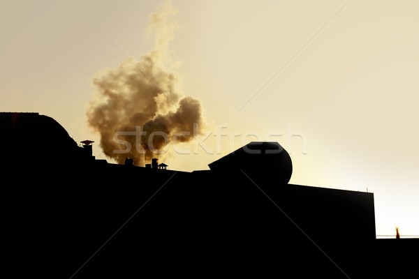 Chimeney on an industrial factory, smoke  backlight Stock photo © lunamarina