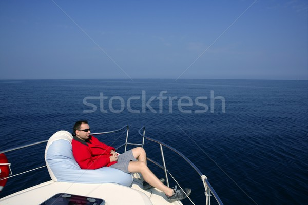 Man on bow boat relaxed on bean bag Stock photo © lunamarina