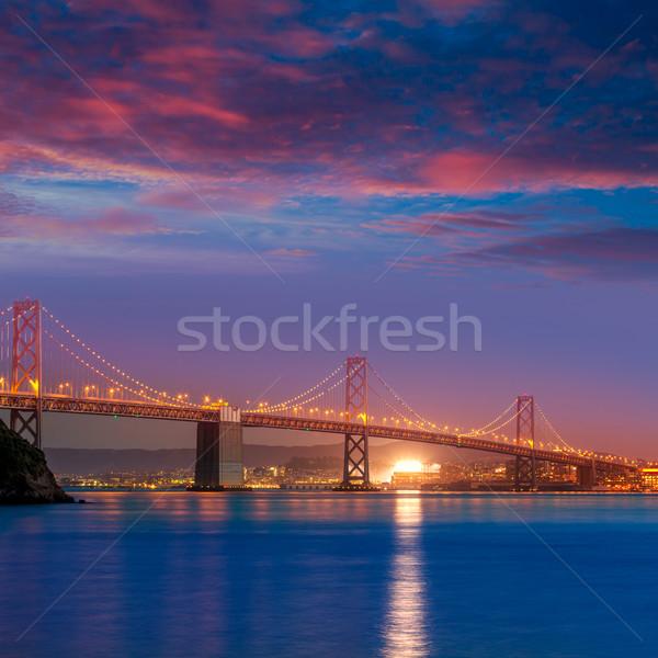 Bay Bridge at sunset in San Francisco California Stock photo © lunamarina