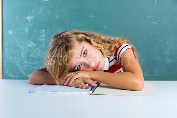 Boring sad expression student schoolgirl on desk Stock photo © lunamarina