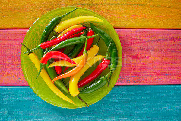 Colorful mexican chili peppers in wood table Stock photo © lunamarina