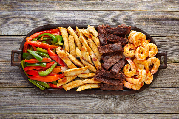 Mexican combo beef chicken fajitas shrimp Stock photo © lunamarina