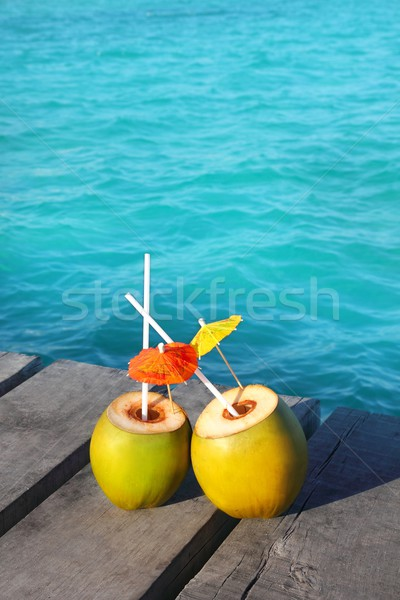 coconut coktails in caribbean on wood pier Stock photo © lunamarina