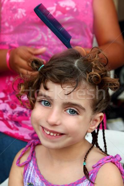 little girl in hairdresser preparing braided hair Stock photo © lunamarina