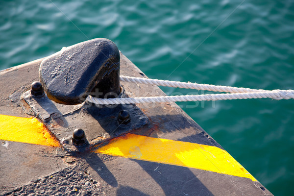 Bollard in port with rope looped around Stock photo © lunamarina