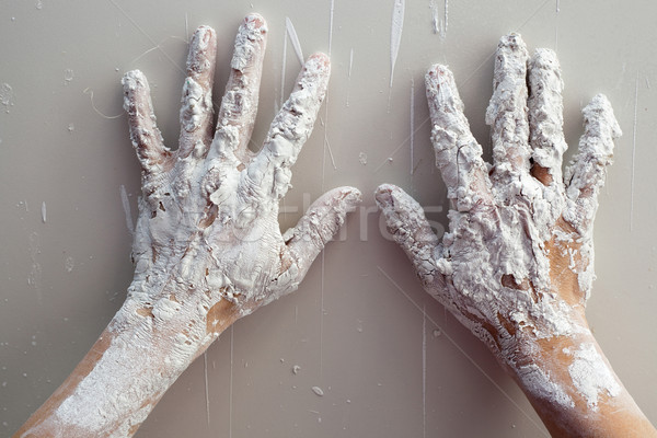 Astist plastering man hands with cracked plaster Stock photo © lunamarina