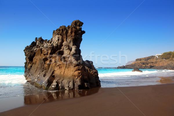 Strand zwarte bruin zand water Stockfoto © lunamarina