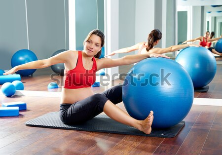 blue toning ball in women pilates class rear view Stock photo © lunamarina