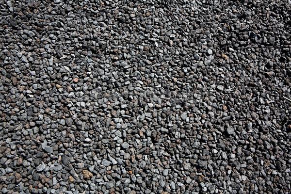 Fekete vulkáni láva kövek minta textúra Stock fotó © lunamarina