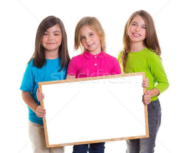 children girls group holding blank white board copy space Stock photo © lunamarina