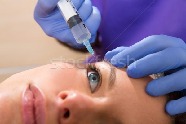 Veroudering spuit vrouw gezicht gezicht oog Stockfoto © lunamarina