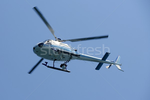 Stock photo: Helicopter holding video camera filming