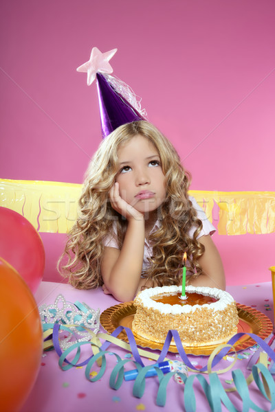 bored little blond girl in a birthday party with candle cake Stock photo © lunamarina