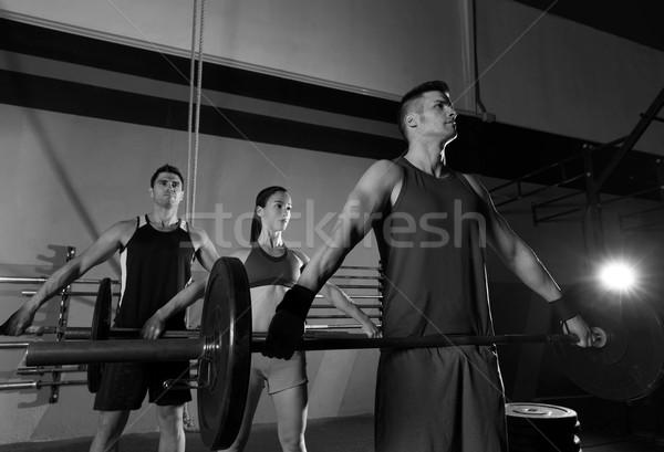 Barbell haltérophilie groupe entraînement exercice gymnase Photo stock © lunamarina