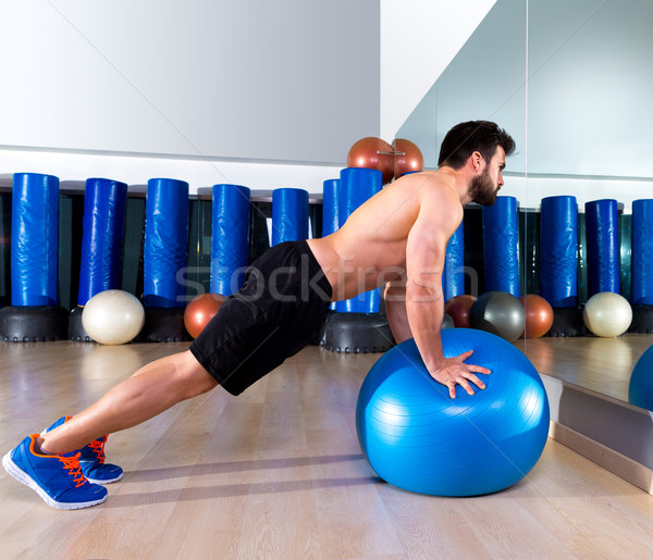 Fitball abdominal push ups Swiss ball man Stock photo © lunamarina