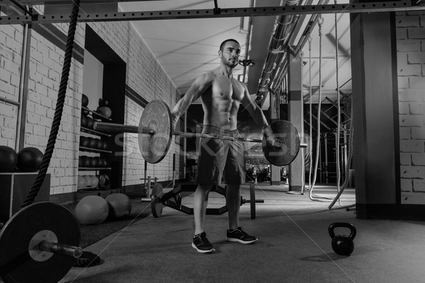 Barbell weight lifting man workout exercise gym Stock photo © lunamarina