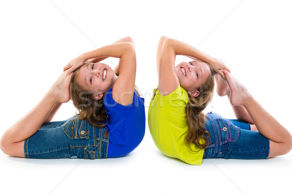 twin kid sisters symmetrical flexible playing happy Stock photo © lunamarina