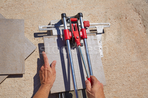 tile cutter machine with mason hands cutting Stock photo © lunamarina