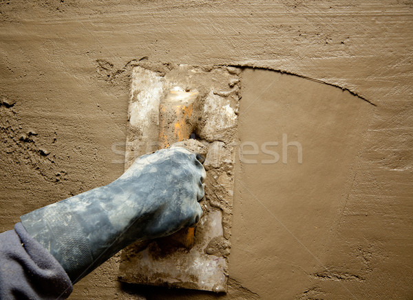 trowel with glove hand plastering cement mortar Stock photo © lunamarina