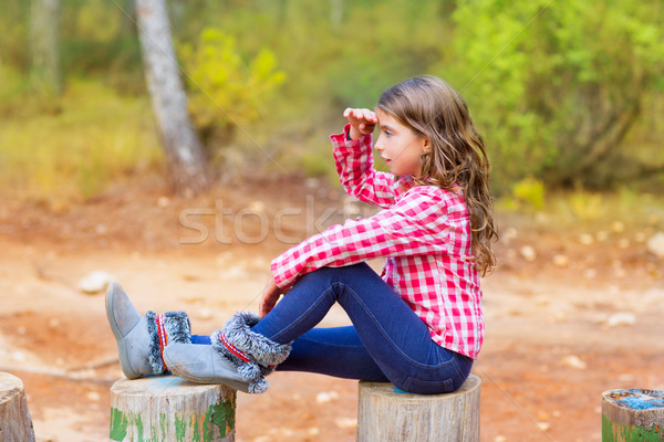 Kid girl sitting in forest trunk looking far away Stock photo © lunamarina