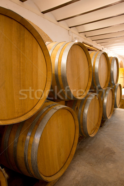 wine wooden oak barrels stacked in a row at winery Stock photo © lunamarina