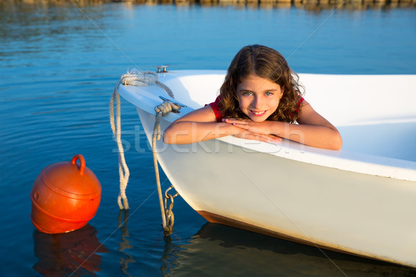 Sailor kid girl happy smiling relaxed in boat bow Stock photo © lunamarina