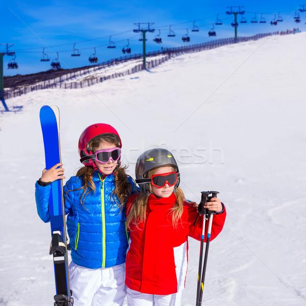 Kid girls sister in winter snow with ski equipment Stock photo © lunamarina