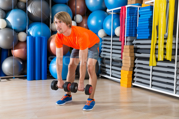 dumbbell deadlift blond man at gym weightlifting Stock photo © lunamarina