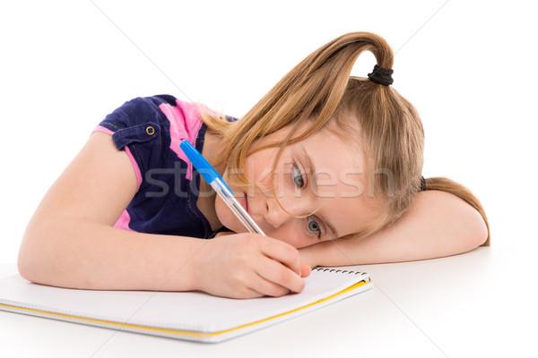 Blond kid girl student with spiral notebook in desk Stock photo © lunamarina