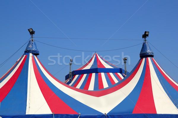 Circus tent under blue sky colorful stripes Stock photo © lunamarina