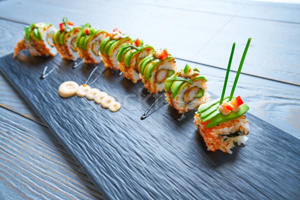Dragon shape Sushi rice roll Stock photo © lunamarina