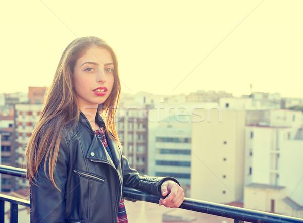 Teenager rock girl standing outdoor at roof terrace Stock photo © lunamarina