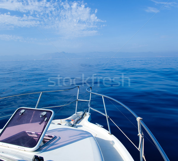 Blue sea boat sailing with open bow porthole Stock photo © lunamarina