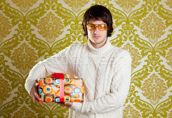 retro hip young man glasses holding  gift box Stock photo © lunamarina