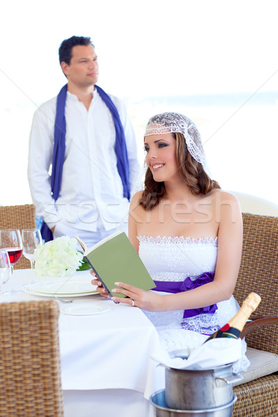 Couple in wedding day woman reading book on banquet Stock photo © lunamarina