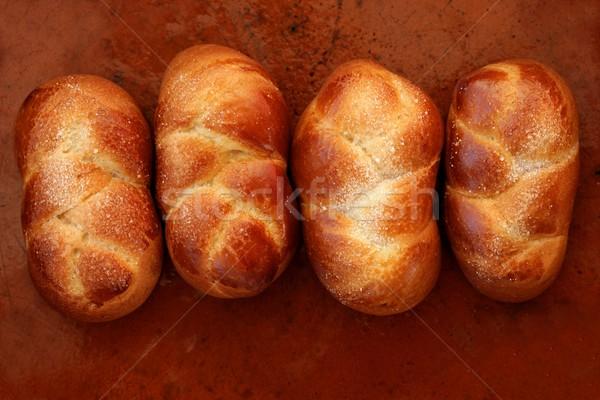 Four brioche pastries over orange clay Stock photo © lunamarina