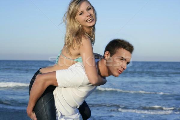 Young beautiful couple playing on the beach Stock photo © lunamarina