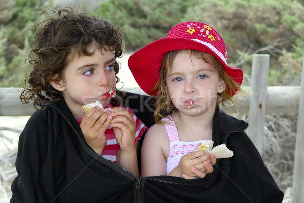hungry sisters summer cold day wrap big jacket Stock photo © lunamarina