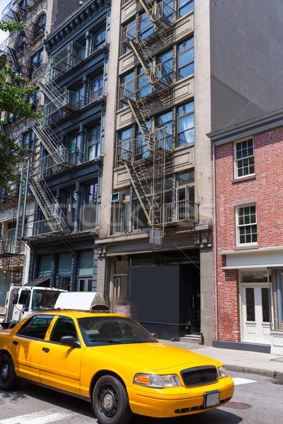 New York Soho buildings yellow cab taxi NYC USA Stock photo © lunamarina