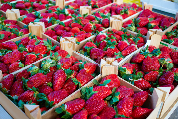Strawberries boxes baskets texture in market Stock photo © lunamarina